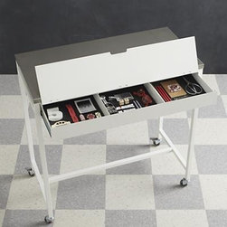 Work Table with Stainless Steel Top - Our exclusive multi-tasking table on wheels lets you work smarter, not harder. Steel and white table makes a modern statement in convenience and organization, with a smooth worktop, flip-top drawer for keyboard or compartmentalized storage, and easy portability. Table acts as a high desk, drafting or hobby table, utility area or garage. Narrow profile allows it to tuck out of the way in a small space.