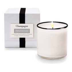 House and Home Champagne / Penthouse Candle - The House and Home Champagne/Penthouse Candle takes elegant fragrance to a higher level. The natural, soy-based candle boasts a clean and sparkling scent with whispers of grapefruit, ginger, raspberry, and lemon. This elegant candle features a distinctive white art glass vessel with a tuxedo black rim.