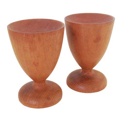 Vintage Mid-Century Wood Candle Holders - An elegant pair, this vintage twosome is rooted in mid-century modern design. Made in Japan and constructed from teak wood, the set of two candle holders taper at the middle and would make a great fit for any modern or retro home.