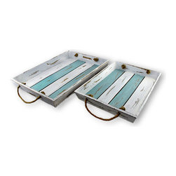 Pair of Distressed Finish Blue And White Slat Board Serving Trays - This pair of nesting wooden slatboard trays not only adds a shabby chic touch to your decor, they are fully functional for transporting food and drinks. Each tray has a alternating pale blue and white painted pattern, artificially distressed to give them an aged, weather-beaten look. The larger tray measures 18 inches by 12 3/4 inches and the smaller one is 14 1/2 inches by 10 3/4 inches. They have natural fiber rope handles.