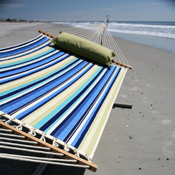 Pawleys Island Hammocks - Pawleys Island Beaches Quilted Duracord Fabric Hammock Multicolor - QBE01 - Shop for Hammocks from Hayneedle.com! Additional features Overall hammock length: 13 ft. Polyester fiberfill batting Weather-resistant DuraCord rope The beach-inspired Pawleys Island Beaches Quilted Fabric Hammock is specifically designed with Duracord fabric which offers resistance to fading mildew and stains. These soft and supple fabrics are quilted together around a thin polyester fiberfill batting that provides maximum comfort. Solid oak spreader bars are hand-dipped with multiple coats of weather-resistant marine varnish. You'll love relaxing in this hammock and enjoying the coordinating stripes of blue and citron as well as a natural stripe reminiscent of pearly sand beaches. How does DuraCord differ from other fabrics? DuraCord is a hybrid fiber due to the many alterations that are made to its base ingredient. It is manufactured in a much smaller denier size meaning individual fibers are smaller making more fibers per yarn. The fibers go through a special texturizing process to give it its soft-to-the-touch cotton-like feel. Fibers are de-lustered to take away the shiny look of the yarn and give it a cotton-like look. DuraCord fabrics are abrasion resistant easy to clean stain resistant color fast fade resistant and have 1 000+ hours of UV resistance. The DuraCord fibers have the properties to make them durable for long outdoor life but without the synthetic feel. About Pawleys IslandIn 1889 the Original Pawleys Island Rope Hammock was created at Pawleys Island one of the oldest summer resorts on the South Carolina coast. When river boat pilot Captain Joshua John Ward found the grass-filled mattresses on his boat too hot in the summer he decided to make a cool and comfortable cotton rope hammock to use on his boat. After several uncomfortable designs Cap'n Josh made a hammock using wooden spreaders without knots. This original design has proven to be so comfortable that it's still used in Pawleys Island's popular hammocks over a century later. Pawleys Island continues to use the highest-quality materials when making its traditional all-cotton rope spun polyester rope and DuraCord hammocks. The custom-designed stretcher bars are cut from seasoned Carolina red oak then steamed bent drilled sanded and varnished to impart a comfortable sway to the hammock and to spread the rope evenly for optimum stability. The people of The Original Pawleys Island Rope Hammock are incredibly proud to be anything but new-fangled. Now 120 years old and counting they continue to offer the very best of their past hoping it will help you better enjoy your future.