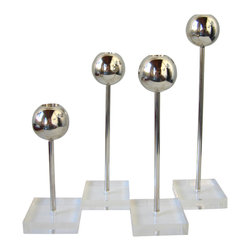 Boom - Lucite and Steel Candleholders, Set of 4 - Modern and industrial are quickly becoming a classic pairing. These candleholders are the perfect blending of styles and materials and would look amazing on your dining room table or credenza. Just add a pop of color with the candles and you'll pull together a bold look.