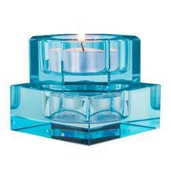 Orrefors - Totem Serenity Blue Votive Pair - This Karim collection brings out that sense of artistic expression we all have hidden away inside.  Totem is a modular take on lighting that reflects a fun approach to decorating.                                                                                                                                                                                 Start with a Serenity votive; add a piece of Balance, Tranquility or Harmony to create your own personal totem.  Mix the colors with each other or with clear and your creation will be brilliant!