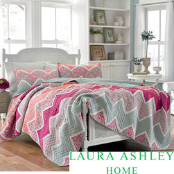 Laura Ashley - Laura Ashley 'Ainsley' Cotton Quilt and Optional Sham Separates - These Laura Ashley quilt and shams are sold separately and are a great way to update the bedroom. The cotton quilt is pieced and reverses to a tonal print to create a completely different look for the room.