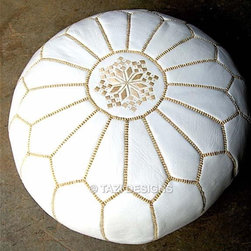 White Pouf with Gold - Every mom needs a stylish place to rest her tired feet. A Moroccan pouf like this one is a departure from a glider's matching ottoman. Plus, toddlers love to play on them when they get a little older.