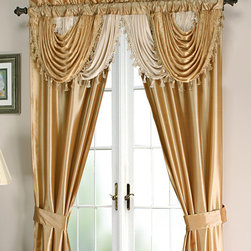 Regal Home Collections - Gold Amore Five-Piece Window Set - This comprehensive set features an attached valance with decorative trim, two panels and two-tie backs that together elevate the look of your living room window.   Includes valance, two panels and two-tie backs 54'' W x 84'' H Polyester Hand wash Imported