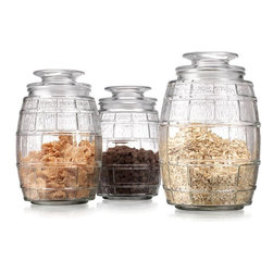 "Home Essentials - Classic Barrel Shaped Glass Canister Set - Storage becomes an essential part of your home decor with our charming and ever so practical canister set! Its clear glass construction allows you to see exactly whats in the jar, and the air tight lids help keep food tasty and fresh. Use these jars for front-of-house displays to hold candy and sweets. Or, use them back in your kitchen to hold the flour and sugar you use during baking. Whatever you decide to use them for, these glass jars are sure to keep your pantry shelves and kitchen counters organized. * Set of 3 * Height: Large: 8"" tall, Medium: 7.5"" tall, Small: 7"" tall * Capacity: Large: 56 oz., Medium: 46 oz., Small: 36 oz."