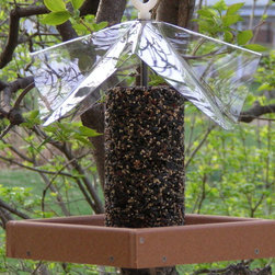 Songbird Essentials - Recycled Poly Yumbrella Deluxe - Holds up to a 72 oz. seed cylinder. Stainless steel hardware will not rust. Clear cover protects seeds and birds from weather. Recycled Poly Lumber Tray is guaranteed not to crack, split or fade!