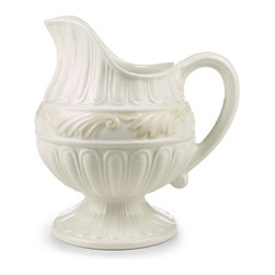 Lenox - Lenox Butlers Pantry Creamer - 6098511 - Shop for Condiment Supplies from Hayneedle.com! Serve your guests cream with their tea and coffee in the exquisitely designed Lenox Butlers Pantry Creamer. Fashioned from gorgeous ivory-hued stoneware this creamer features an a graceful easy-to-hold handle and upturned spout for ease of use. You'll love the gorgeous scalloping and sculpting on this creamer which is also oven- and microwave-safe at low temperatures.About Lenox CorporationLenox Corporation is an industry leader in premium tabletops giftware and collectibles. The company markets its products under the Lenox Dansk and Gorham brands propelled by a shared commitment to quality and design that makes the brands among the best known and respected in the industry. Collectively the three brands share 340 years of tabletop and giftware expertise.