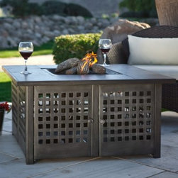 Uniflame Propane Gas Fire Pit with Grey Slate Top - Uniflame Propane Gas Fire PIt with Grey Slate Top. Unwind at the end of a busy day and enjoy a cozy evening under the stars with the glow of a warm soothing fire. This LP Gas Fire Pit is full of beautiful textures and materials and features stunning details. Lava rocks and logs are included! The metal base has a clean grid pattern and a charcoal finish. A hand-crafted tile mantel in charcoal gray adds a sophisticated touch to your patio. The porcelain steel bowl will withstand the high temps Includes a fire pit protective cover to keep this fire pit looking good and protected from the elements. This fire pit is a snap to light thanks to the electronic ignition but it looks totally natural due to the hidden control panel. It includes lava rocks and realistic looking ceramic logs. Requires 20-lb. propane tank not included. Some assembly required. About Blue Rhino/Uniflame/Endless Summer:Blue Rhino Global Sourcing Inc. is America's #1 propane tank exchange brand but it doesn't stop there. Blue Rhino is a leading designer and marketer of outdoor appliances and fireplace furnishings. These products include barbecue grills outdoor heaters outdoor fireplaces mosquito traps and fireplace furnishings. You'll find a Blue Rhino product in the middle of half a billion barbecue events nationwide every year. They come under various brand names including UniFlame Endless Summer and SkeeterVac.