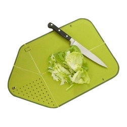 Joseph Joseph - Joseph Joseph Rinse&Chop Plus, Green - Rinse&Chop Plus is a folding, non-slip chopping board with integrated colander. Designed by Design Wright. Rinse&Chop Plus is the latest version of this hugely popular, folding chopping board, incorporating an improved, curved colander feature and a non-slip base. When folded and locked, its unique, innovative design creates a small colander at one end enabling food to be rinsed and drained. When opened and laid flat the design becomes a knife-friendly, non-slip chopping board.Once chopping is complete the board can be folded and locked again to create a convenient chute down which chopped food or waste can be poured. Its non-slip edge prevents the board from sliding if stored upright and the locking hole in the design doubles as a convenient hanging point. Dishwasher safe.