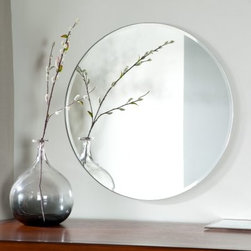 Frameless Tori Wall Mirror - 23.5 diam. in. - Add soft lines to your decor with the Frameless Tori Wall Mirror. This gorgeous round mirror brightens up any room in your home. Constructed of metal and strong 3/16 glass it features a deep bevel design around the border. Mounting hardware is included with the mirror. Weighs 11 pounds. Dimensions: 23.5L x 23.5W x .5D inches.