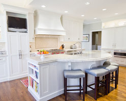Broadway Interiors - Designed by Gina Vannerson at Broadway Interiors in Paducah, Kentucky, this traditional kitchen features beaded inset maple cabinetry with a painted white finish manufactured by WoodArt Fine Cabinetry.  The large custom island features a solid beadboard back panel in a radius design.