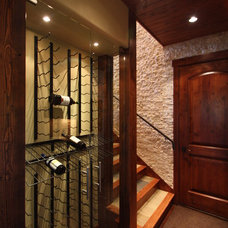 Traditional Wine Cellar by Pinnacle Mountain Homes