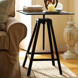 """Potter's Wheel Accent Table - Pottery Barn - This accent table was inspired by potter's wheels, that spin to allow sculptors to mold clay from all angles. I like it because you can adjust the height to suit your needs.22"""" square, 25–38"""" high. Handcrafted of iron."""