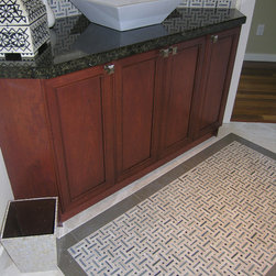 Tile Details - A tile rug in the floor always adds a lot to the look of a both. using a mosaic and bordering it is an easy way to create this detail. The design impact becomes greater when the materials a repeated in other area's of the room. Alie Zandstra