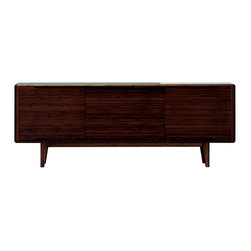 Greenington LLC - Greenington Currant Sideboard - Dark Walnut Brown - G0025DW - Shop for Buffets and Side Boards from Hayneedle.com! Those sleek legs are the hallmark of Mid-Century modern design. The Greenington Currant Sideboard - Nutmeg has them and details to spare. This sideboard offers three notched doors that open to reveal plenty of storage and the generous top is there to accommodate. It's beautifully crafted of fully sustainable eco-friendly Moso bamboo. The dark walnut finish perfectly accentuates the wood grain. About Greenington LLC.Greenington LLC manufactures the finest natural bamboo furniture available on the market. Bamboo is strong and grows rapidly making it an ideal material for furniture as well as an earth-friendly environmentally sustainable resource. Greenington offers a full line of unique high-quality bamboo furniture for the bedroom living room dining room and office and its products include tables chairs benches and complete bedroom sets (bed nightstands and dressers). Greenington LLC also provides bamboo wine cabinets bamboo stools and much more.