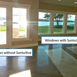 Lakefront home with Suntuitive windows - Pleotint is the world's top innovator in self-tinting windows and produces Suntuitive®, a simple glass technology that uses heat from sunlight to tint windows when necessary. On sunny days, Suntuitive® will gradually darken its tint to balance the intensity of light and heat coming through your windows, all while continuing to preserve your view outside. Pleotint is dedicated to provide customers with naturally brilliant windows that increase energy efficiency and optimize their comfort and view.
