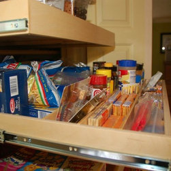 Pull Out Pantry Shelves with Shelf Dividers - Our roll out pantry shelves are custom made.  The close up on this pantry shelf shows our shelf dividers which are a great organizational tool for keeping items separated on your shelf.
