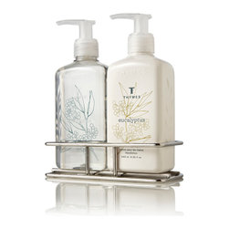 Eucalyptus Sink Set - Luxury hand wash with a transitional, botanical look in its signature labeling matches its companion hand cream in the Eucalyptus Sink Set, a pair of luxurious necessities for freshening your hands and pampering your spirit. Both purely-scented bottles of liquid wash and hand lotion are contained by a glossy nickel-hued caddy that creates a narrow footprint for easy balancing by the sink.