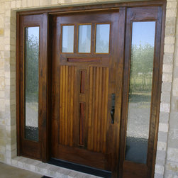 Moore Residence - Walnut door unit with Teak bead board panels, inset cherry panels.  The sidelites operate like casement windows.  There are screen doors on the interior.  This allows a breeze without a screen door. Photo By Ivan Moses