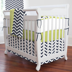 "Navy and Citron Zig Zag Mini Crib Bedding - Classic navy and spicy citron green unite to create a ""must have"" baby bedding collection. Your decorating possibilities are endless with this timeless combination of style and color. The modern Chevron print offers a hip new approach to your nursery decor. Perfect for smaller nurseries or for staying at Grandma's, portable mini-cribs are a great space-saving alternative to standard sized cribs. Our mini-crib bedding is designed to fit portable cribs using mattresses measuring approximately 24"" x 38""."