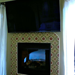 Project Photos - Bedroom fireplace project decorated with hand painted raised decorative ceramic tiles.