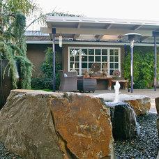 Midcentury Patio by Gardenart Group
