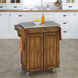 HomeStyles - Kitchen Cart in Cottage Oak Finish - Add an extra counter to your kitchen with this mobile kitchen cart! It features an easy to clean salt and pepper granite top, a cottage oak finished cabinet for lots of storage and extra compartments for everything you need! * Cuisine salt and pepper granite top. Utility drawer. Two cabinet doors open to storage with adjustable shelf inside. Handy spice rack. Towel bar. Heavy duty locking rubber casters for easy mobility and safety. Finish helping to protect against wear from normal use. Made from Asian hardwood. Made in Thailand. Assembly required. 32.5 in. L x 18.75 in. W x 35.5 in. HHome Styles' Creat-a-Cart is a unique and refreshing solution for kitchen utility.