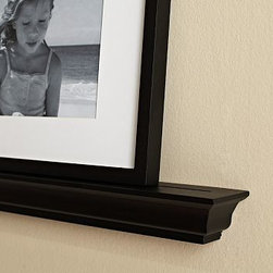"Crown Molding Picture Ledge, 3', Black - Stage a series of changing displays on these architecturally contoured ledges. 2' wide x 3"" deep x 2.5"" high 3' wide x 3"" deep x 2.5"" high 4' wide x 3"" deep x 2.5"" high Made of alder wood with a black-painted finish, or a mahogany stained finish. A small groove near the front of the ledge keeps frames in place. Watch a video on how to install {{link path='/stylehouse/videos/videos/h2_v3_rel.html?cm_sp=Video_PIP-_-PBQUALITY-_-HANG_LEDGESSHELVES' class='popup' width='420' height='300'}}ledges and shelves{{/link}}."
