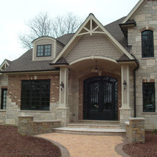 Traditional Exterior by Buechel Stone Corp