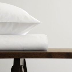 """Area - STELLA Bedding Collection by Area - Bedding as pure and white as the driven snow (but much more comfortable to sleep on). The Area STELLA Bedding Collection is made out of soft 400 thread count cotton percale in a clean and versatile white tone that will coordinate with virtually any other style or color of bedding. Founded in 1990 by Swedish fashion designer Anki Spets, Area creates fine modern bedding based on the Scandinavian design tradition of """"good design for everyday."""" Based in New York City, Area sets itself apart by designing and producing long-lasting textiles with lovely original patterns, carefully chosen colors and subtle detailing. On top of that, Area sheets, blankets and duvet covers are made using only the finest organic cotton, linen and baby alpaca wool."""