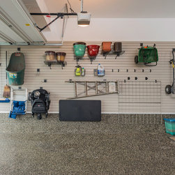 Garage Organization - This customer's garage was entered into the local Parade of Homes. It features our organizing wall system, fold down work bench, and unique poly-terrazzo floor coating to transform this garage into a beautifully organized, transitional living area.