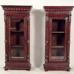 Pair Of 1900's Moroccan Style Bookcase - Beautiful pair of antique Moroccan Style bookcases. This 1900's pieces are exquisitely designed with carved columns on two sides and intricate hand carvings on the top, side and bottom. The bookcases have a walnut wood finish and are adorned with mother of pearl insert on four corners.