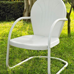 Crosley Furniture - Metal Chair in White - UV resistant. Warranty: 90 days. Made from steel. Non-Toxic powder coated finish. Assembly required. 28.5 in. W x 21 in. D x 34.5 in. H (15 lbs.)Relax outside for hours on our nostalgically inspired Griffith metal outdoor furniture. Kick back while you reminisce in this sturdy steel chair, designed to withstand the hottest of summer days and other harsh conditions. The chairs non-toxic, powder-coated finish is available in various colors to complement your outdoor accessories.