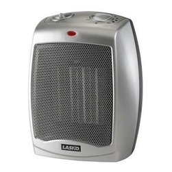 Lasko Products - Ceramic Heater With Thermostat - Leave that bulky extra sweater in the drawer. This small yet powerful ceramic heater features three settings and an adjustable thermostat so you'll always be warm, cozy and comfortable.