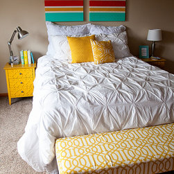 Bright accents on an all white bed - This cheery bedroom created by Heather of Whipperberry is the perfect combination of white and brights.  The Valencia White duvet adds just enough texture, while the yellow creates a fun pop.