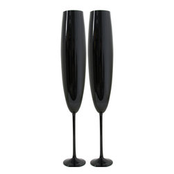 Martinka Crystalware & Lifestyle - Midnight Sky , Champagne Flutes (Set of 2) - Sip champagne in style with these sleek champagne flutes. The Midnight Sky Champagne Flutes are handmade from ultra light weight glass. The black glass exhibits a beautiful purple hue as light passes through. Whether you are looking for a unique gift or just want a chic way to toast bubbly, these eye-catching stems can add a special touch to the experience.
