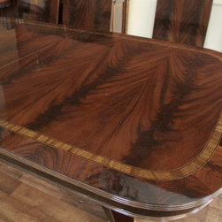 Large Mahogany Antique Reproduction Dining Table (LH 4 3B) - Flame mahogany field with satin wood and mahogany wood banding and a reeded edge.