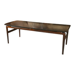Consigned Mid-Century Coffee Table by Peter Hvidt - Excellent condition 1957 design. Solid rosewood construction by Peter Hvidt and Orla Morlgaard for France & Son, Denmark. Hidden, laminated return on one side.
