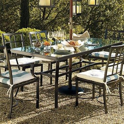"Riviera Rectangular Dining Table, 72 x 38"" - Cast of strong, lightweight aluminum, our Riviera Dining Table has the subtle curves and substantial presence of classic resort furniture. Click to read an article on {{link path='pages/popups/riviera-care_popup.html' class='popup' width='640' height='700'}}recommended care{{/link}}. 72"" wide x 38"" deep x 30"" high; comfortably seats 6 Cast entirely of rustproof, weather-resistant aluminum with a black finish. Add the optional tempered-glass top for easy serving and cleanup. An opening at the center accommodates all of our outdoor umbrellas. Simple assembly. Catalog / Internet only. View our {{link path='pages/popups/fb-outdoor.html' class='popup' width='480' height='300'}}Furniture Brochure{{/link}}."