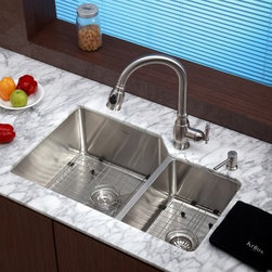 Kraus KHU123-32-KPF2150-SD20 Double Basin Undermount Kitchen Sink - The Kraus KHU123-32-KPF2150-SD20 Double Basin Undermount Kitchen Sink is the complete package with everything you need to keep your kitchen moving along smoothly. Easily switch from normal flow to strong spray with the push of a button on the arching faucet. This set is made to last and last against corrosion from stainless steel.Product SpecificationsNumber of Basins: 2Bowl Depth (inches): 10Weight (pounds): 36Low Lead Compliant: YesEco Friendly: YesMade in the USA: YesHandle Style: LeverValve Type: Ceramic DiscFlow Rate (GPM): 2.2Spout Height (inches): 8.27Spout Reach (inches): 10.04About KrausWhen you shop Kraus, you'll find a unique selection of designer pieces, including vessel sinks and faucet combinations. Kraus incorporates its distinguished style with superior functionality and affordability, while maintaining highest standards of quality in its vast product line. The designers at Kraus are continuously researching and exploring broader markets, seeking new trends and styles. Additionally, durability and reliability are vital components at Kraus for developing high-quality fixtures. Every model undergoes rigorous testing and inspection prior to distribution, with customer satisfaction in mind. Step into the Kraus world of plumbing perfection. With supreme quality and unique designs, you will reinvent how you see your bathroom decor. Let your imagination become reality!