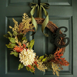 Rustic Fall Monogram Wreath - An autumn door wreath dressed in a collection of fall colors featuring an off white hydrangea complemented with berries, peony leaves and finished with parsley green satin ribbon.