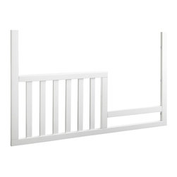 Sealy - Sealy Bella Toddler Rail & Daybed Conversion Kit - AQ603-TNQ1 - Shop for Daybeds from Hayneedle.com! As reluctant as you may be to have your baby grow up your little one is just as excited about the prospect; and the Sealy Bella Toddler Rail and Daybed Conversion Kit helps you both out with that big move. This clever conversion kit helps you help your little one explore new boundaries and newfound freedoms while acknowledging that some extra precautions are still necessary. Keeping your little one safely tucked in tight on one end and providing an opening to assume new big-kid responsibilities on the other this toddler rail has the best of both worlds. And when your tot has mastered the whole big-kid bed thing the front rail can be removed leaving the two vertical side rails attached for a finished sophisticated daybed look. The clean lines and Tranquility Gray finish of this kit are made to seamlessly match the midcentury modern style of the Sealy Bella 3-in-1 Conversion Crib helping you to extend the life of the quality furniture you've invested in for your baby. After all growing up is a process that comes in stages - thank goodness.About SealyFrom the first cotton-filled mattresses made by Daniel Haynes in 1881 to the Sealy Posturepedic mattresses of today the Sealy name has been synonymous with sleep for more than 125 years. Named for the small town in Texas where the company had its beginnings Sealy Corporation through its subsidiaries is the largest bedding manufacturer in North America. It produces a diversified line of mattress and foundation products including the Sealy Sealy Posturepedic and Sealy Posturepedic Luxury Collection mattresses as well as important component parts used inside mattresses.America's best-selling mattress company Sealy currently operates 31 plants which manufacture bedding in 20 states three Canadian provinces Mexico Puerto Rico Brazil Argentina France and Italy. Staff at their research and development center in High Point 