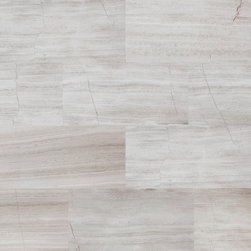 Birch Planks 12 x 24 - The natural grey striations on a background of soft grey Limestone emulate the naturally beauty of the iconic birch tree. Whether in a soothing spa bathroom or an elegant main room, Birch will make any space, contemporary or classic, feel refined. Available in two sizes, in honed or polished finish.