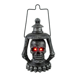 `Graveyard Guide` LED Skull Hanging Lantern - This cool skull lantern is an essential addition to the home of any fan of the macabre. Made of cold cast resin, it measures 7 1/2 inches tall (9 1/2 inches with the hanger), 5 inches wide, and 8 inches deep. An on/off switch on the bottom allows you to control the glowing red eyes that are powered by 3 button call batteries (included) This piece is great to display around Halloween time, or any time of the year if you love skulls. It is sure to be noticed and start a conversation.