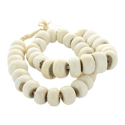 White Bone Beads - Though they are carved from bone, these pale chalk-white rondelle beads look as though they might be hand-rolled in unfinished pottery with their matte finish and slight irregularities of shape and size. This chunky knotted strand can be put to dozens of uses in the home, bringing an African-import flavor in blending neutral colors to your decor. A perfect transitional accessory, they're superb for easing the formality of a stiff vignette with a more natural spontaneity.