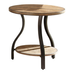 "Steve Silver Furniture - Steve Silver Denise Round End Table in Light Oak - Charming primitive style combines with modern curves to create the alluring Denise Collection. The Denise cocktail table stands 24"" high, with a 24"" round barn board look wood top, metal frame and a wood bottom shelf. This unique-Piece complements the Denise End table and sofa table."