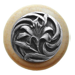 """Inviting Home - Tiger-Lily Natural Maple Wood Knob (clear finish with antique pewter) - Tiger-Lily Natural Maple Wood Knob in clear finish with hand-cast antique pewter insert; 1-1/2"""" diameter Product Specification: Made in the USA. Fine-art foundry hand-pours and hand finished hardware knobs and pulls using Old World methods. Lifetime guaranteed against flaws in craftsmanship. Exceptional clarity of details and depth of relief. All knobs and pulls are hand cast from solid fine pewter or solid bronze. The term antique refers to special methods of treating metal so there is contrast between relief and recessed areas. Knobs and Pulls are lacquered to protect the finish. Alternate finishes are available. Detailed Description: A very detailed and beautiful knobs are the Tiger Lily knobs. They are very delicate and bears a lot of positive history. The Tiger Lily is an orange flower that is covered in spots. It has been a useful medical remedy for many centuries. Its scent is said to suppress aggressive behavior and promotes overall good feeling. The smell is said as a superstition to give whoever smells it freckles."""