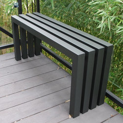 Sarabi - Sarabi Linear Bench - Gunmetal Gray Multicolor - 1008 - Shop for Benches from Hayneedle.com! Create cool contrast in natural outdoor or warm indoor settings with the modern minimal Sarabi Linear Bench - Gunmetal Gray. Crafted with durable fully welded steel tubing cut in clean segments and simply joined this artful bench has a wide-open seat and an understated gunmetal gray powder coat finish. It slips in virtually anywhere - the porch the patio the dining room the entryway the end of the bed. We've got two generous sizes so there's a bench to fit every space you've got for one. Dimensions: 40W x 11D x 18H inches 58W x 11D x 18H inchesAbout Sarabi StudioIn Austin Texas it takes three to produce Sarabi Studio's super-modern wares: a lead designer a stainless steel and mild steel artist and a woodworker and metal finisher. Together they create hand-crafted furniture with the ideals set forth by proprietor - and that lead designer - Payam Sarabi: designs that turn heads and make a bold minimal statement.